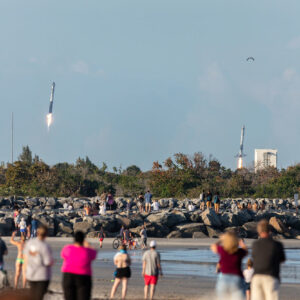 Two SpaceX Falcon Heavy boosters return to the Cape Canaveral Air Force Station after successfully launching the ARABSAT-6A satellite into orbit.
