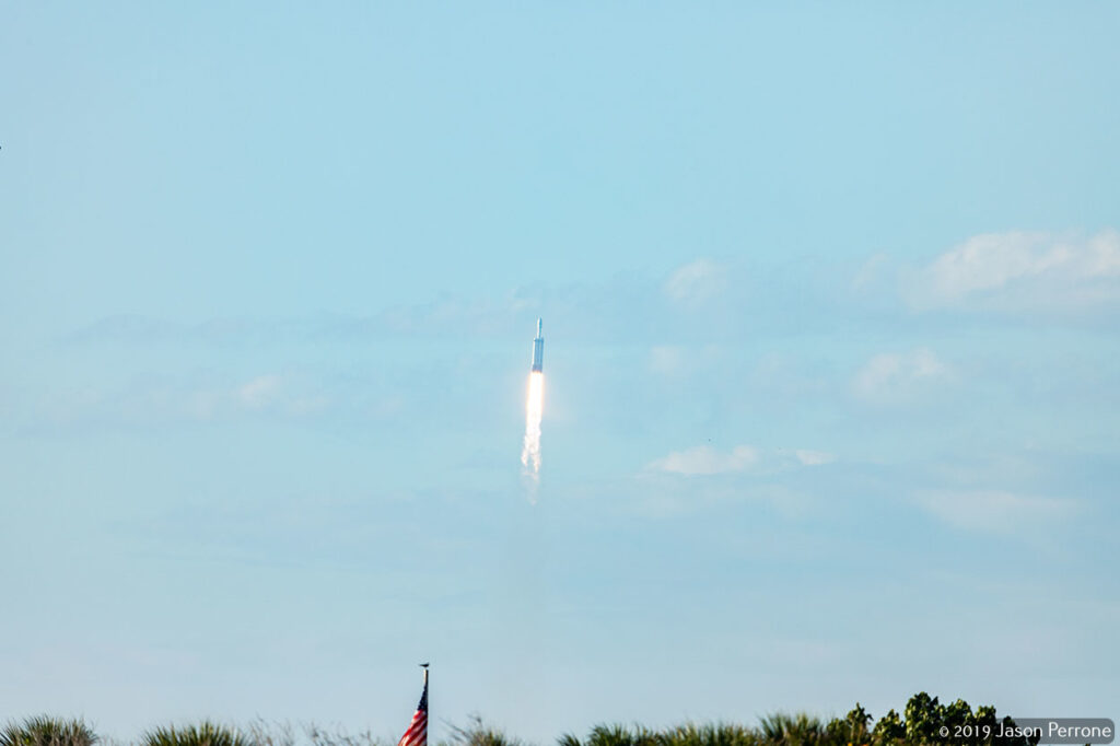A SpaceX Falcon Heavy rocket lifts off for Pad 39A at the Kennedy Space Center in Florida carrying the ARABSAT-6A satellite into orbit.