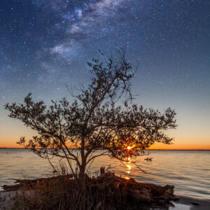Composite image of the Milkyway galaxy with the sunset viewed from the Manatee Park in Cape Canaveral, Florida.